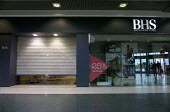 Shutters coming down as customers leave. Closing BHS Store Telford Shopping Centre Shropshire. 11,000 jobs go as Retail Acquisitions put the department store into administration - John Harris - 24-04-2016