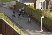 Teenagers playing on the streets Longbridge Birmingham - John Harris - 2010s,2016,adolescence,adolescent,adolescents,bicycle,bicycles,BICYCLING,Bicyclist,Bicyclists,BIKE,BIKES,Birmingham,boy,boys,child,CHILDHOOD,children,cities,City,cycle,cycles,cycling,Cyclist,Cyclists,