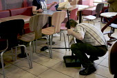 Worker cleaning the floor, McDonald's Restaurant Oldbury West Midlands - John Harris - 23-04-2016