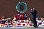 Floral tributes to the 96 victims of the Hillsborough disaster, Anfield football ground Liverpool. Liverpool football banners, flags and floral memorials - John Harris - 27-04-2016
