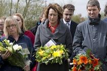 John McGhee FBU with floral tributes, International Workers Memorial Day, memorial tree and plaque, National Memorial Arboretum, Alrewas, Staffordshire - John Harris - 28-04-2016