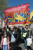 PCS trade union members at the front of the demonstration May Day Rally. - Stefano Cagnoni - 2010s,2016,activist,activists,banner,banners,CAMPAIGN,campaigner,campaigners,CAMPAIGNING,CAMPAIGNS,DEMONSTRATING,Demonstration,DEMONSTRATIONS,May Day,member,member members,members,PCS,people,Protest,P