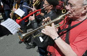 Musicians playing The Internationale May Day Rally London - Stefano Cagnoni - 2010s,2016,activist,activists,brass,brass instrument,CAMPAIGN,campaigner,campaigners,CAMPAIGNING,CAMPAIGNS,DEMONSTRATING,Demonstration,DEMONSTRATIONS,Internationale,London,May Day,melody,member,member