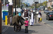 Mother collecting child from nursery, Foleshill Coventry - John Harris - 2010s,2016,adult,adults,age,ageing population,Asian,Asians,BAME,BAMEs,black,BME,bmes,CARE,carer,carers,CHILD,childcare,CHILDHOOD,CHILDMINDING,CHILDREN,cities,City,collecting,communities,community,conf