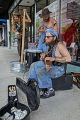 Asheville, North Carolina USA, A jug band busking in the street - Jim West - American,2010s,2016,America,American,americans,Appalachia,Appalachian band,Appalachian dulcimer,Asheville,baggar,band,bands,beg,beggar,beggars,BEGGER,begging,begs,busker,buskers,busking,cities,City,co