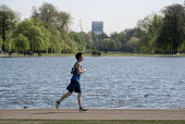 Young man jogging, Kensington Gardens, London - Philip Wolmuth - tourism, tourists,2010s,2016,cities,City,exercise,exercises,exercising,holiday,holiday maker,holiday makers,holidaymaker,holidaymakers,holidays,jogger,joggers,jogging,Kensington,lake,lakes,Leisure,LFL