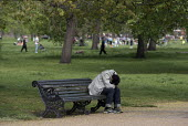 Man sleeping on a park bench, Kensington Gardens, London - Philip Wolmuth - 2010s,2016,alone,asleep,BAME,BAMEs,bench,bereavement,Black,BME,bmes,cities,City,committed,committing,cry,crying,DEATH,DEATHS,demoralised,demoralized,depressed,depression,deprivation,despair,despondent