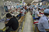 Hanoi Vietnam Sewing machine operators at work, May 10 Garment Factory. The factory was state owned when it began 29 years ago and is now half-owned by private capital. It makes garments for LExpress,... - David Bacon - 15-12-2015