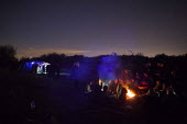 Illegal rave or free party, Huddersfield, West Yorkshire, round the campfire - Connor Matheson - 22-04-2016