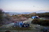 Illegal rave or free party, Huddersfield, West Yorkshire, round the campfire - Connor Matheson - 2010s,2016,alcohol,binge,camp,campfire,camping,camps,CLUBBING,dance,dancer,dancers,dancing,drink,drinking,drug,drugs,drunk,drunken,drunkenness,early morning,enjoy,enjoying,enjoyment,getting high,havin