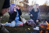 Illegal rave or free party, Huddersfield, West Yorkshire, round the campfire - Connor Matheson - 2010s,2016,alcohol,binge,camp,campfire,camps,CLUBBING,dance,dancer,dancers,dancing,drink,drinking,drug,drugs,drunk,drunken,drunkenness,early morning,enjoy,enjoying,enjoyment,FEMALE,getting high,having