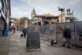 Elderly people walking past the demolition of Castle Market, Sheffield, Yorkshire - Connor Matheson - 2010s,2015,adult,adults,age,ageing population,animal,animals,bed,beds,bought,buy,buyer,buyers,buying,canine,Castle,cities,City,commodities,commodity,Construction Industry,consumer,consumers,customer,c