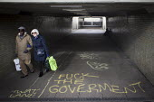 Political graffiti on the floor of an underpass tunnel, Sheffield, Yorkshire - Connor Matheson - 2010s,2016,adult,adults,age,ageing population,Anarchism,Anarchist,Anarchists,architecture,bag,bags,BAME,BAMEs,black,BME,bmes,bought,buildings,buy,buyer,buyers,buying,cities,City,commodities,commodity,