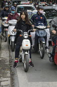 Hanoi, Vietnam, streets filled with scooters and motorbikes - David Bacon - 2010s,2015,Asia,asian,asians,asiaregi,bike,busy,EBF,Economic,Economy,FEMALE,Hanoi,highway,moped,mopeds,motorbike,MOTORBIKES,MOTORCYCLE,MOTORCYCLES,motorcycling,people,person,persons,rider,riders,ridin