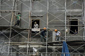 Construction workers and scaffolding on a building site, Hanoi, Vietnam - David Bacon - 09-12-2015