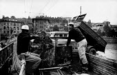 Florence Floods, Italy, 1966 in which 100 died and many cultural artefacts, books, paintings and sculptures were damaged. It was the worst flood for five hundred years. Damaged paintings on the back o... - Romano Cagnoni - 11-11-1966