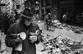 Man with tins of food from a distribution centre, Florence Floods, Italy, 1966. The floods in Florence in early November 1966 were the worst in over five hundred years and resulted in the loss of over... - Romano Cagnoni - 14-11-1966