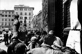 Florence Floods, Italy, 1966 in which 100 died and many cultural artefacts, books, paintings and sculptures were damaged. It was the worst flood for five hundred years. A long queue on the Piazza dell... - Romano Cagnoni - 11-11-1966