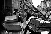 Florence Floods, Italy, 1966 in which 100 died and many cultural artefacts, books, paintings and sculptures were damaged. It was the worst flood for five hundred years. In the poor quarter of Piazza G... - Romano Cagnoni - 14-11-1966