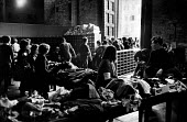 Florence Floods, Italy, 1966 in which 100 died and many cultural artefacts, books, paintings and sculptures were damaged. It was the worst flood for five hundred years. Distributing clothing to local... - Romano Cagnoni - 11-11-1966