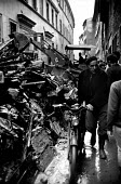 Florence Floods, Italy, 1966 in which 100 died and many cultural artefacts, books, paintings and sculptures were damaged. It was the worst flood for five hundred years. Digger piling rubbish on one si... - Romano Cagnoni - 11-11-1966
