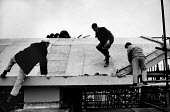 The rebuilding of Coventry Cathedral, completed in 1962, more than two decades after suffering terrible damage as a result of bombing during the Second World War. Roofers working on the roof of the Ca... - Alex Low - 03-03-1962