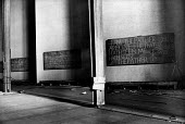 The rebuilding of Coventry Cathedral, completed in 1962, more than two decades after suffering terrible damage as a result of bombing during the Second World War. Biblical inscriptions etched onto the... - Alex Low - 03-03-1962