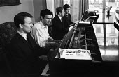 Performance of Concerto for Eight Hands on Two Pianos composed by Malcolm Williamson, 1965. L to R Richard Rodney Bennett, Peter Maxwell Davies, Malcolm Williamson and Thea Musgrave - Romano Cagnoni - 08-04-1965