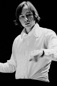 Composer Peter Wiegold conducting, Purcell Rooms, South Bank, London, 1975 - John Sturrock - 1970s,1975,ACE,Arts,Bank,BANKS,cities,city,classical music,composer,Composers,concert,CONCERTS,conducting,conductor,conductors,contemporary music,Culture,London,melody,modern,music,MUSICAL,musician,mu