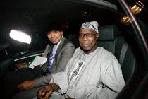 Former Nigerian President Olusegun Obasanjo leaving the London School of Economics (LSE). He gave a lecture on the unrest in the Democratic Republic of Congo (DRC). - Justin Tallis - 2000s,2009,activist,activists,arrival,arrivals,arrive,arrives,arriving,AUTO,AUTOMOBILE,AUTOMOBILES,AUTOMOTIVE,BAME,BAMEs,black,BME,bmes,CAMPAIGNING,CAMPAIGNS,car,CARS,Congo,corrupt,corruption,DEMONSTR