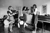 Helen Brunner teaching violin using the Suzuki method to children at her home, London, 1970. These were some of the first lessons using the Japanese method of teaching the violin in the UK - Jeanne Hendry - 25-08-1970