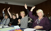 Delegates voting at the Women's TUC, 2015. - Janina Struk - 2010s,2015,ACTIVIST,activists,CAMPAIGN,campaigner,campaigners,CAMPAIGNING,CAMPAIGNS,cheerful,conference,conferences,congress,delegate,delegates,delegation,democracy,EMOTION,EMOTIONAL,EMOTIONS,europere