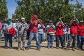 California USA, Farmworkers rally after work to show support for their union, the UFW, at Klein Management Company. Workers at the company pick blueberries. After the company cut their wages, workers... - David Bacon - 21-05-2016