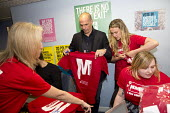 Yanis Varoufakis signing t-shirts at a Labour Party Momentum stand. Another Europe is Possible conference, Vote In campaign. UCL Institute of Education. London. - Jess Hurd - 28-05-2016