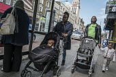 Two women with push-chairs, Kilburn, London. - Philip Wolmuth - 2010s,2016,adult,adults,babies,baby,BAME,BAMEs,black,BME,bmes,bought,boy,boys,buggies,buy,buyer,buyers,buying,child,CHILDHOOD,children,cities,City,commodities,commodity,consumer,consumers,customer,cus