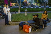 Hanoi, Vietnam A bride and groom having their picture taken at night by Hoan Kiem Lake, a custom for women about to get married - David Bacon - 05-01-2016