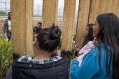 Tijuana Mexico USA border. Every Sunday Mexicans meeting family members on the USA side through the border fence, Parque de Amistad, or Friendship Park, Tijuana where the wall runs into the Pacific Oc... - David Bacon - 29-05-2016