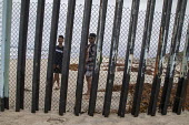 Tijuana Mexico USA border. Every Sunday Mexicans meeting family members on the USA side through the border fence, Tijuana where the wall runs into the Pacific Ocean - David Bacon - 29-05-2016