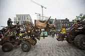 Punkx festival celebrating 40 years of punk, performance from the Mutoid Waste Company, Kings Cross, London. Triceratops Tractor taking on Giant bull created by Jo Rush - Jess Hurd - 2010s,2016,ACE,art,arts,artwork,artworks,AUTO,AUTOMOBILE,AUTOMOBILES,AUTOMOTIVE,car,cars,CELEBRATE,celebrating,cities,city,Company,culture,custom,customised,customized,dinosaur,dinosaur.dinosaurs,dino