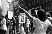 National Front demonstration to Conway Hall, Red Lion Square 1974 and counter demonstration led by Liberation, London An anti-Fascist protestor mocks the NF marchers with a Nazi style salute. In the r... - Mike Tomlinson - 15-06-1974