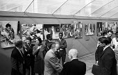 Opening of a photographic exhibition by Romano Cagnoni of Report on Biafra during the Nigerian Civil War, London, 1969. The exhibition was staged in a tent in Trafalgar Square and sponsored by The Spe... - Patrick Eagar - 1960s,1969,ACE,Art Gallery,artist,ARTISTS,Arts,Biafra,Biafran,cities,city,Civil War,Culture,exhibition,James Cameron,journalist,journalists,London,male,man,men,Nigeria,Nigerian,Opening,people,person,p