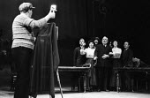 Better Times written by Barrie Keeffe, staged at Theatre Royal Stratford East, London 1985. The play tells the story of the 1921 Poplar Rates revolt. ~Gordon Kaye playing the Daily Herald photographer... - Stefano Cagnoni - 1980s,1985,ACE,act,acting,actor,actors,actress,actresses,arts,cities,city,culture,drama,DRAMATIC,entertainment,FEMALE,Gordon Kaye,historical drama,London,people,person,persons,photographer,play,playin