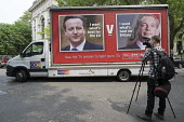 Video journalist. Launch of EU Referendum campaign poster, London - Philip Wolmuth - 2010s,2016,advertisement,advertisements,billboard,BILLBOARDS,Brexit,camera,cameras,campaign,campaigning,CAMPAIGNS,EU,Europe,eurosceptic,Euroscepticism,eurosceptics,far right,far right,HAULAGE,HAULIER,