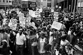 Supporters of Biafra protest against the British Government supplying arms to Nigeria during the Civil War, London, 1968 - Romano Cagnoni - 1960s,1968,activist,activists,against,BAME,BAMEs,Biafra,Biafran,black,black activism,BME,bmes,bus,bus service,BUSES,CAMPAIGN,campaigner,campaigners,CAMPAIGNING,CAMPAIGNS,Civil War,DEMONSTRATING,demons