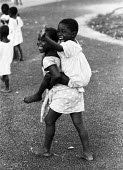 Biafran children who lost their parents during the Nigerian Civil War, orphanage, Sao Tome, 1968 - Romano Cagnoni - Africa,1960s,1968,African,Biafra,Biafran,boy,boys,camp,camps,child,CHILDHOOD,children,Civil War,conflict,Conflicts,Diaspora,displaced,EMOTION,EMOTIONAL,EMOTIONS,families,FAMILY,foreign,foreigner,forei