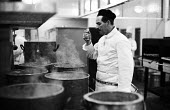 Preparations for the Lord Mayor of London's Banquet, Guildhall, London 1958. Chef tasting the soup in the kitchen - Alan Vines - 1950s,1958,AFFLUENCE,AFFLUENT,Bourgeoisie,check,checking,chef,chefs,cities,city,cook,cooker,COOKERY,cooking,cooking utensils,cooks,EBF,Economic,Economy,elite,elitism,employee,employees,Employment,EQUA