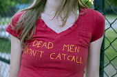 Detroit, Michigan, A young woman wearing a t-shirt with a slogan Dead Men Dont Catcall - Jim West - 03-06-2016