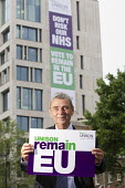 Dave Prentis, Unison Gen Sec with Unison Vote Remain, Don't Risk Our NHS banner, Unison HQ, Euston, London - Jess Hurd - 2010s,2016,campaign,campaigning,CAMPAIGNS,care,Dave Prentis,democracy,EU,European Union,Euston,health,HEALTH SERVICES,healthcare,HQ,London,member,member members,members,NATIONAL HEALTH SERVICE,NHS,peo
