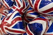 Inflatable Union Jack flags for sale to celebrate the Queen's Birthday. Queen Elizabeth II 90th birthday celebration weekend, Morrisons Supermarket, Stratford upon Avon - John Harris - 11-06-2016