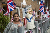 Christine Johnson with her Queen gnome. Queen Elizabeth II 90th birthday celebration weekend, Tower Hamlets, East London - Jess Hurd - 2010s,2016,2nd,90th,birthday,BIRTHDAYS,bunting,CELEBRATE,CELEBRATING,celebration,CELEBRATIONS,cities,city,East London,Eastender,eastenders,Elizabeth,FEMALE,flag,flags,gnome,gnomes,identity,leisure,lfL